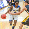 "Point guard Benissa Bulaya drives toward the lane during the first half of the championship game of the North Star Invitational Tournament against Wayne State in the Patty Gym.  <div class=""ss-paypal-button"">Filename: ATH-13-4010-23.jpg</div><div class=""ss-paypal-button-end"" style=""""></div>"