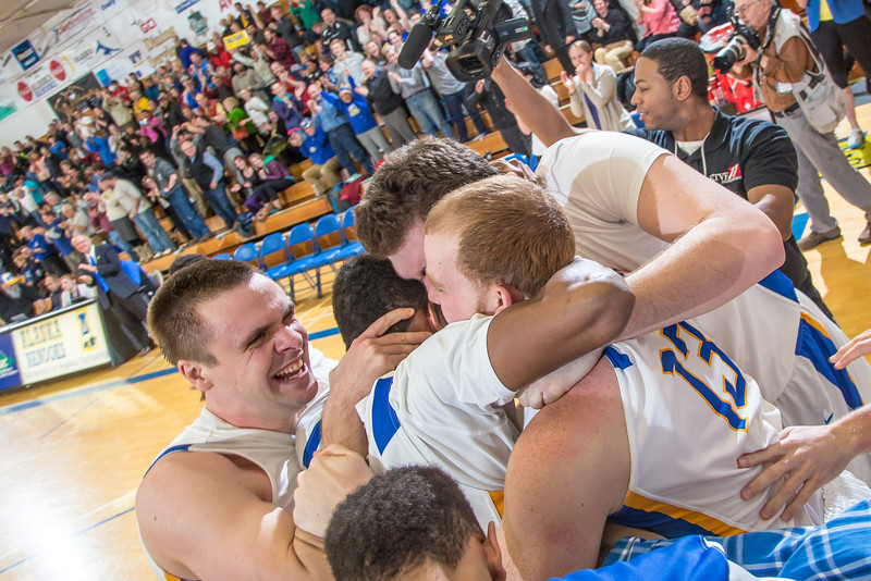 """Senior Andrew Kelly is mobbed by his teammates moments after scoring at the buzzer to lead the Nanooks to an incredible come-from-behind victory over the UAA Seawolves on Senior Night in the Patty Gym.  <div class=""""ss-paypal-button"""">Filename: ATH-14-4097-49.jpg</div><div class=""""ss-paypal-button-end"""" style=""""""""></div>"""