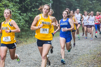 Hannah Stevens and other Lady Nanooks compete against runners from Montanta State University and Seattle Pacific University at a foggy Saturday morning on campus.  Filename: ATH-13-3933-69.jpg
