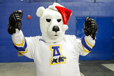 The UAF Nanook Mascot is pumped for the 2nd Annual Teddy Bear Toss Saturday, Dec. 8, 2012, during a hockey game against Bowling Green at the Carlson Center. The Student-Athlete Advisory Committee (SAAC) sponsored the event.  Filename: ATH-12-3676-1.jpg