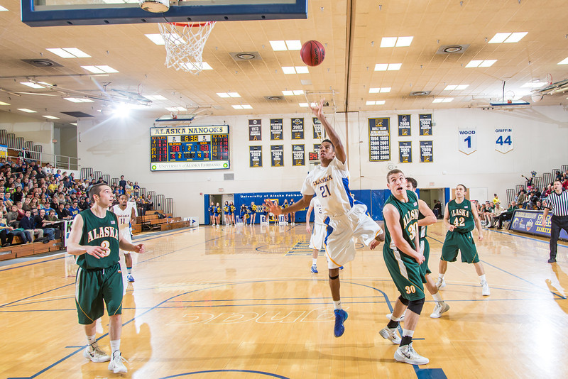 "Senior Andrew Kelly puts up a one-handed shot late in the Nanooks' game against the UAA Seawolves in the Patty Gym. Kelly helped lead the Nanooks from a 13-point second-half deficit and later scored at the buzzer to provide the final margin in their two-point victory.  <div class=""ss-paypal-button"">Filename: ATH-14-4097-6.jpg</div><div class=""ss-paypal-button-end""></div>"