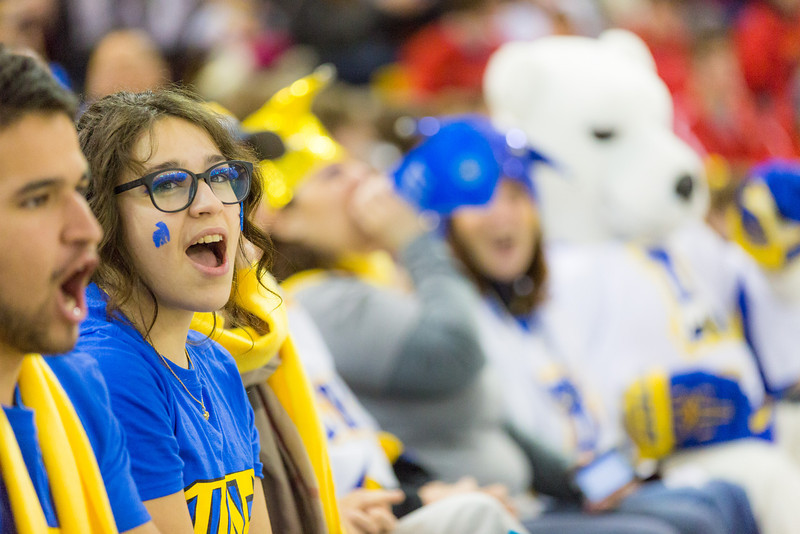 """Mahaut Sorlin cheers with the contingent of UAF supporters during the Alaska Airlines Governor's Cup match between UAF Men's Hockey team and UAA Men's Hockey team at the Sullivan Arena in Anchorage.  <div class=""""ss-paypal-button"""">Filename: ATH-13-4018-59.jpg</div><div class=""""ss-paypal-button-end"""" style=""""""""></div>"""