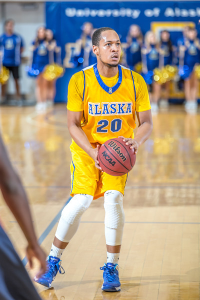 "Junior point guard Joe Slocum sets up to shoot a three-pointer during the Nanooks' 83-72 win over Fresno Pacific in the championship game of the GCI Alaska Invitational tournament.  <div class=""ss-paypal-button"">Filename: ATH-13-4005-60.jpg</div><div class=""ss-paypal-button-end"" style=""""></div>"