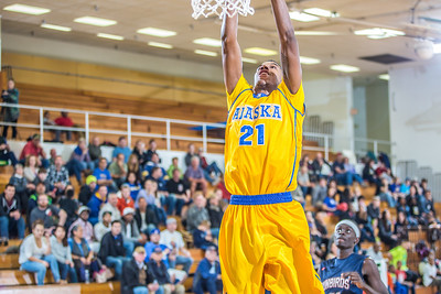 Senior forward Andrew Kelly completes a fast break layup during the Nanooks' 83-72 win over Fresno Pacific in the championship game of the GCI Alaska Invitational tournament. Kelly scored 12 points in the game and was named to the All-Tournament team.  Filename: ATH-13-4005-95.jpg