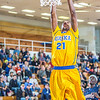 """Senior forward Andrew Kelly completes a fast break layup during the Nanooks' 83-72 win over Fresno Pacific in the championship game of the GCI Alaska Invitational tournament. Kelly scored 12 points in the game and was named to the All-Tournament team.  <div class=""""ss-paypal-button"""">Filename: ATH-13-4005-95.jpg</div><div class=""""ss-paypal-button-end"""" style=""""""""></div>"""
