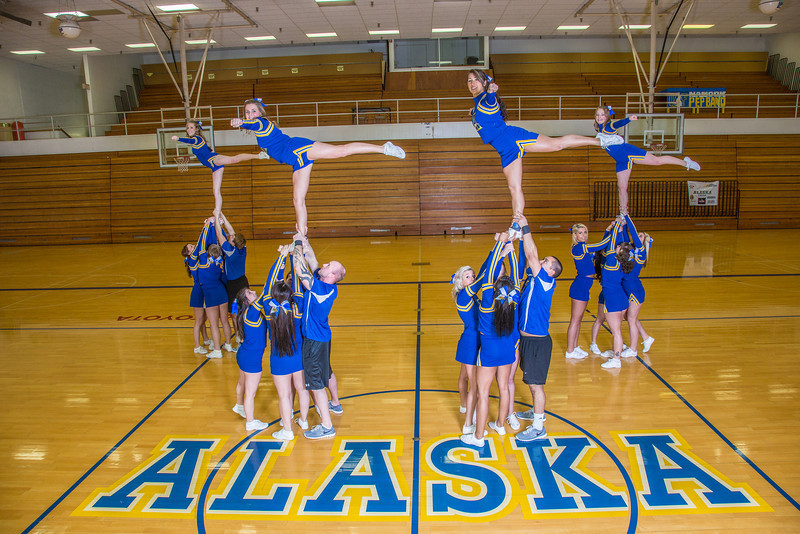 """The 2014 Nanook cheerleaders pose in the Patty Gym.  <div class=""""ss-paypal-button"""">Filename: ATH-14-4044-54.jpg</div><div class=""""ss-paypal-button-end"""" style=""""""""></div>"""