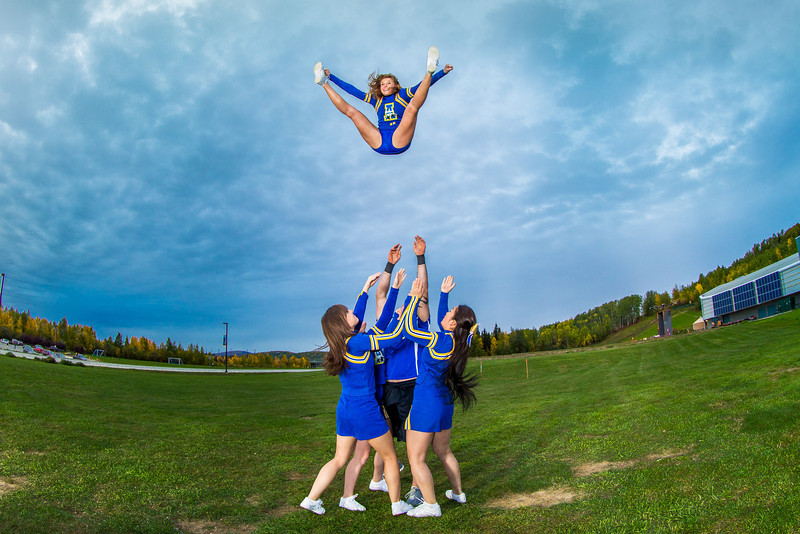 """UAF cheerleaders practice in front of the SRC on the Fairbanks campus.  <div class=""""ss-paypal-button"""">Filename: ATH-13-3943-110.jpg</div><div class=""""ss-paypal-button-end"""" style=""""""""></div>"""