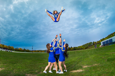 UAF cheerleaders practice in front of the SRC on the Fairbanks campus.  Filename: ATH-13-3943-110.jpg