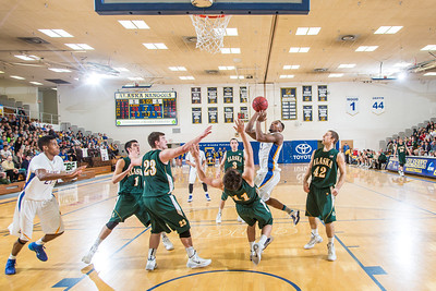 Senior Ronnie Baker was charged with an offensive foul on this play with about five minutes to play in the Nanooks' game against the UAA Seawolves in the Patty Gym. Despite the turnover, Baker helped the Nanooks overcome a 13-point second-half deficit and defeat the Seawolves on a buzzer-beating bucket by Andrew Kelly.  Filename: ATH-14-4097-13.jpg