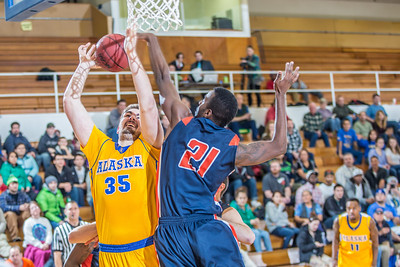 Senior Sergej Pucar gets stymied on his was to the hoop in the Nanooks' 83-72 win over Fresno Pacific in the championship game of the GCI Alaska Invitational tournament. Pucar was a huge factor in the game, scoring 25 points, including 11 straight, during a crucial 23-6 second-half run as the Nanooks pulled away.  Filename: ATH-13-4005-42.jpg