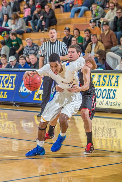 """Senior Andrew Kelly is held on a rather flagrant foul late in the Nanooks' game against Northwest Nazarene in the Patty Gym.  <div class=""""ss-paypal-button"""">Filename: ATH-14-4041-205.jpg</div><div class=""""ss-paypal-button-end"""" style=""""""""></div>"""