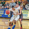 "Senior Andrew Kelly is held on a rather flagrant foul late in the Nanooks' game against Northwest Nazarene in the Patty Gym.  <div class=""ss-paypal-button"">Filename: ATH-14-4041-205.jpg</div><div class=""ss-paypal-button-end"" style=""""></div>"