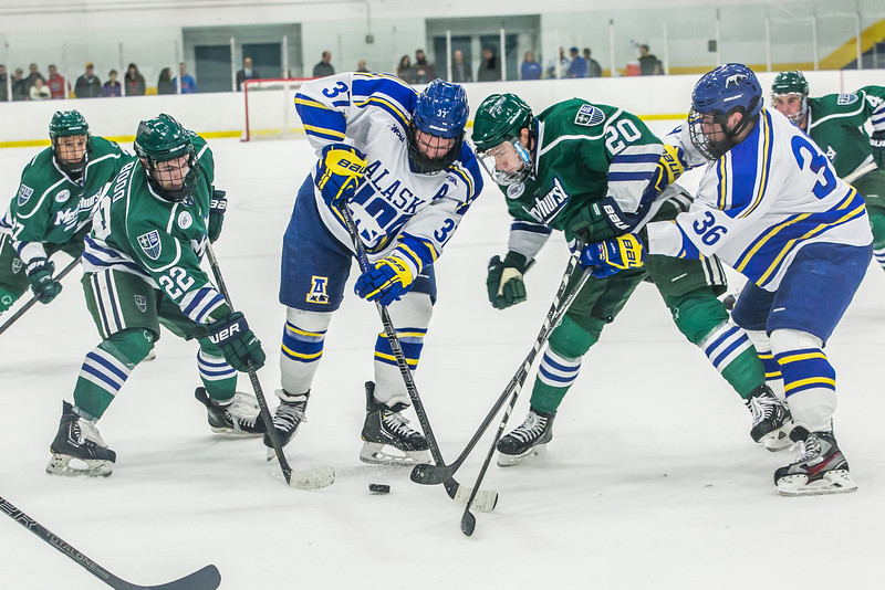 "Seniors Cody Kunyk, 37, and Colton Beck, 36, battle for the puck as they try to preserve a one-goal lead late in the final period of their game against Mercyhurst in the Patty Ice Arena.  <div class=""ss-paypal-button"">Filename: ATH-13-3982-205.jpg</div><div class=""ss-paypal-button-end"" style=""""></div>"