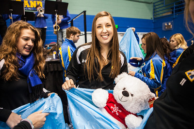 The Student-Athlete Advisory Committee (SAAC) sponsored the 2nd Annual Teddy Bear Toss during the hockey game against Bowling Green State University Saturday, Dec. 8, 2012 at the Carlson Center. The bears were sent to Santa's Clearing House in Fairbanks to be given to families during holiday season.  Filename: ATH-12-3676-78.jpg