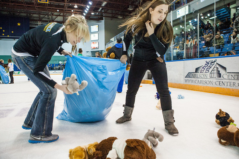 "The Student-Athlete Advisory Committee (SAAC) sponsored the 2nd Annual Teddy Bear Toss during the hockey game against Bowling Green State University Saturday, Dec. 8, 2012 at the Carlson Center. The bears were sent to Santa's Clearing House in Fairbanks to be given to families during holiday season.  <div class=""ss-paypal-button"">Filename: ATH-12-3676-66.jpg</div><div class=""ss-paypal-button-end"" style=""""></div>"