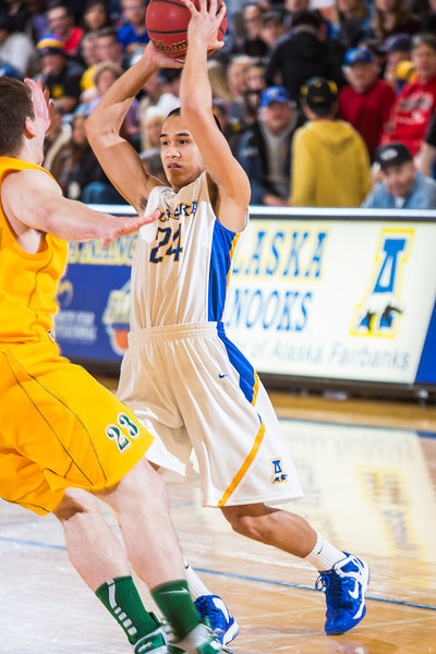 """Junior point guard Pat Voeut looks for an open teammate during the Nanooks game against the UAA Seawolves in the Patty Center.  <div class=""""ss-paypal-button"""">Filename: ATH-13-3700-110.jpg</div><div class=""""ss-paypal-button-end"""" style=""""""""></div>"""