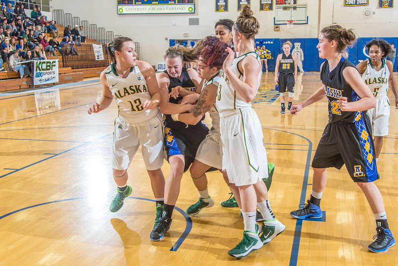 """Freshman Jordan Wilson gets tied up driving to the hoop during the second half of the Nanooks game against the rival Seawolves from UAA Jan. 18 in the Patty Gym.  <div class=""""ss-paypal-button"""">Filename: ATH-14-4041-53.jpg</div><div class=""""ss-paypal-button-end"""" style=""""""""></div>"""