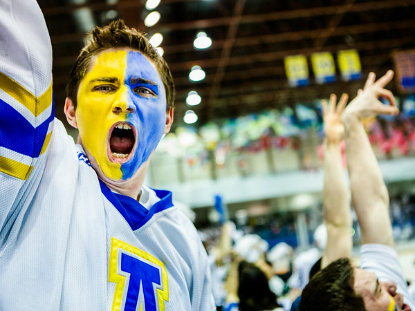 """Robert Depue cheers after the Alaska Nanooks Hockey team score against University of Alaska Anchorage during the 2014 Governor's Cup tournament at the Carlson Center.  <div class=""""ss-paypal-button"""">Filename: ATH-14-4105-19.jpg</div><div class=""""ss-paypal-button-end""""></div>"""