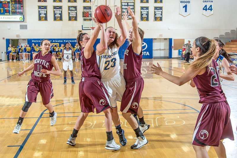 """Freshman forward Jordan Wilson splits two defenders to score two of her game high 25 points during the Nanooks' first GNAC game of the season against Seattle Pacific.  <div class=""""ss-paypal-button"""">Filename: ATH-13-4015-72.jpg</div><div class=""""ss-paypal-button-end"""" style=""""""""></div>"""