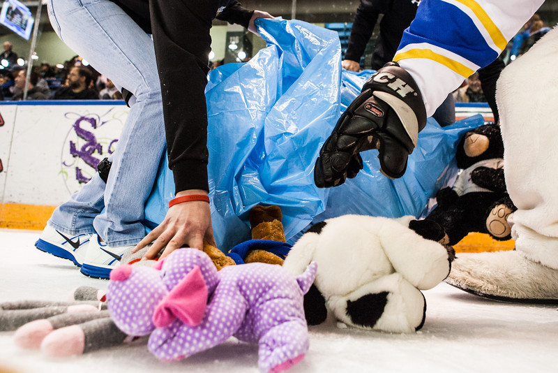 """The Student-Athlete Advisory Committee (SAAC) sponsored the 2nd Annual Teddy Bear Toss during the hockey game against Bowling Green State University Saturday, Dec. 8, 2012 at the Carlson Center. The bears were sent to Santa's Clearing House in Fairbanks to be given to families during holiday season.  <div class=""""ss-paypal-button"""">Filename: ATH-12-3676-70.jpg</div><div class=""""ss-paypal-button-end"""" style=""""""""></div>"""