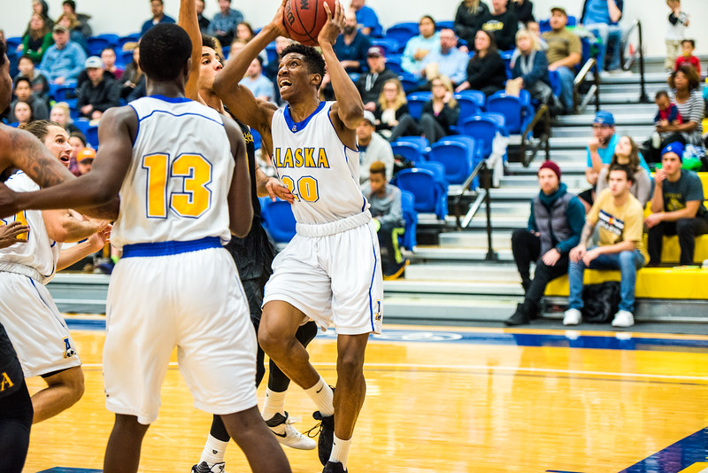 """Bangaly Kaba watches as a player from Cal State LA knocks into Ladonavan Wilder during the Nanooks' game on Nov. 21 in the Patty Gym.  <div class=""""ss-paypal-button"""">Filename: ATH-16-5072-59.jpg</div><div class=""""ss-paypal-button-end""""></div>"""