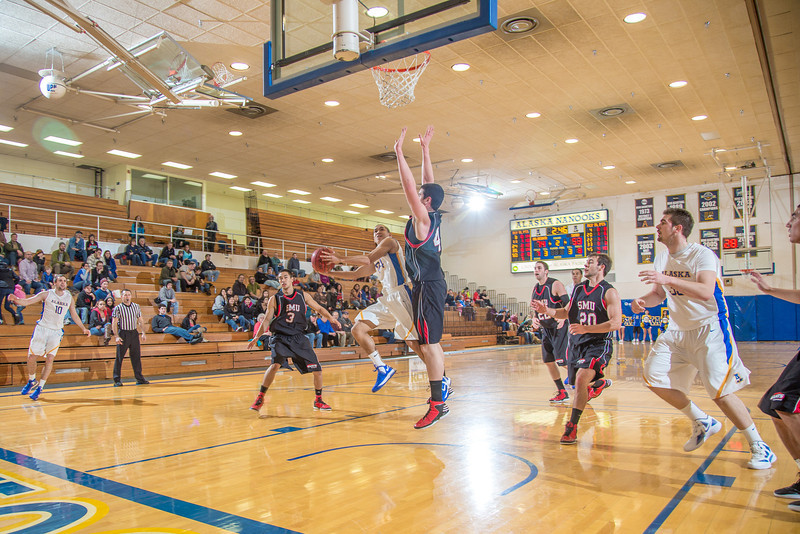 """Junior guard Pat Voeut gets inside for a layup during the second half of the Nanooks' 81-58 win over Saint Martin's Jan. 10 in the Patty Center.  <div class=""""ss-paypal-button"""">Filename: ATH-13-3695-70.jpg</div><div class=""""ss-paypal-button-end"""" style=""""""""></div>"""