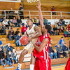 "Guard Ronnie Baker looks to score against a taller Simon Fraser defender during another Nanook win in the Patty Gym.  <div class=""ss-paypal-button"">Filename: ATH-14-4029-100.jpg</div><div class=""ss-paypal-button-end"" style=""""></div>"