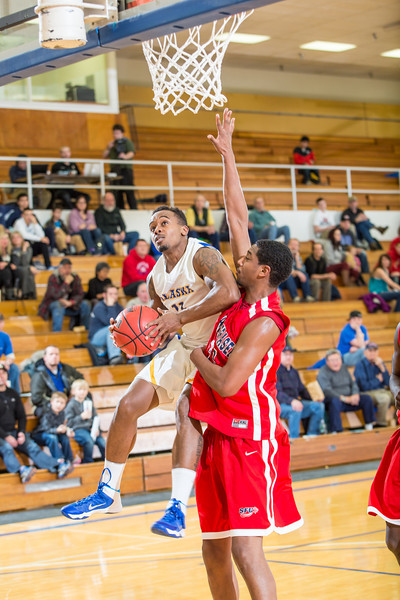 """Guard Ronnie Baker looks to score against a taller Simon Fraser defender during another Nanook win in the Patty Gym.  <div class=""""ss-paypal-button"""">Filename: ATH-14-4029-100.jpg</div><div class=""""ss-paypal-button-end"""" style=""""""""></div>"""