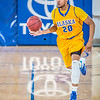 """Junior point guard Joe Slocum pushes the ball upcourt during the Nanooks' 83-72 win over Fresno Pacific in the championship game of the GCI Alaska Invitational tournament.  <div class=""""ss-paypal-button"""">Filename: ATH-13-4005-46.jpg</div><div class=""""ss-paypal-button-end"""" style=""""""""></div>"""