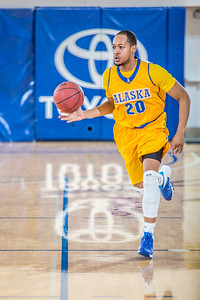 Junior point guard Joe Slocum pushes the ball upcourt during the Nanooks' 83-72 win over Fresno Pacific in the championship game of the GCI Alaska Invitational tournament.  Filename: ATH-13-4005-46.jpg