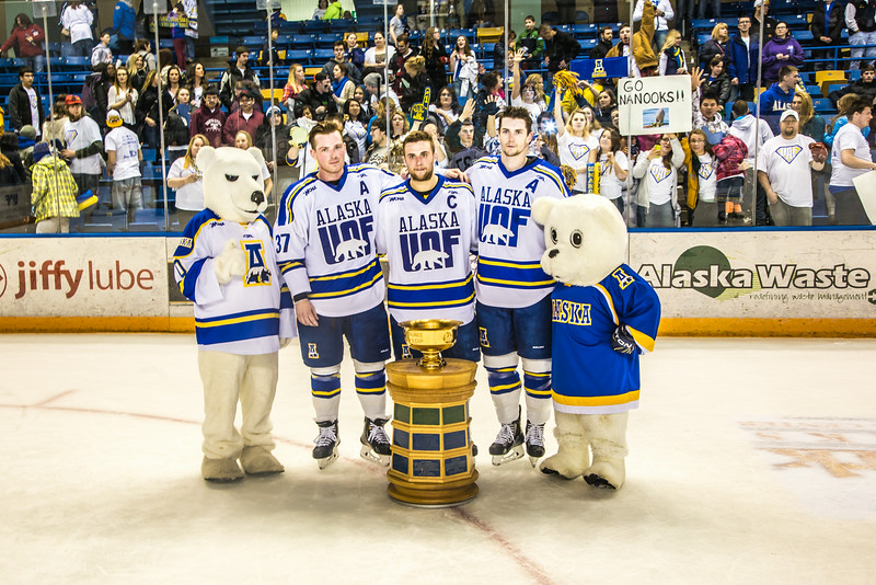 """The Nanook mascots pose with seniors Cody Kunyk, Colten Beck and Michael Quinn after their last regular season game March 8 in the Carlson Center, in which they successfully defended the Alaska's Governor's Cup  with a shoot-out victory over the UAA Seawolves.  <div class=""""ss-paypal-button"""">Filename: ATH-14-4109-343.jpg</div><div class=""""ss-paypal-button-end""""></div>"""