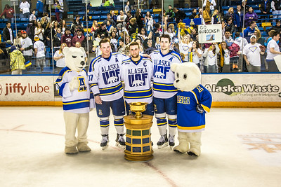 The Nanook mascots pose with seniors Cody Kunyk, Colten Beck and Michael Quinn after their last regular season game March 8 in the Carlson Center, in which they successfully defended the Alaska's Governor's Cup  with a shoot-out victory over the UAA Seawolves.  Filename: ATH-14-4109-343.jpg