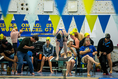 A UAF swimmer stands on the blocks before the 50-yard freestyle during the Nanooks' meet against Concordia-Irvine on Friday, Nov. 11, 2016 in the Patty Pool.  Filename: ATH-16-5059-4.jpg