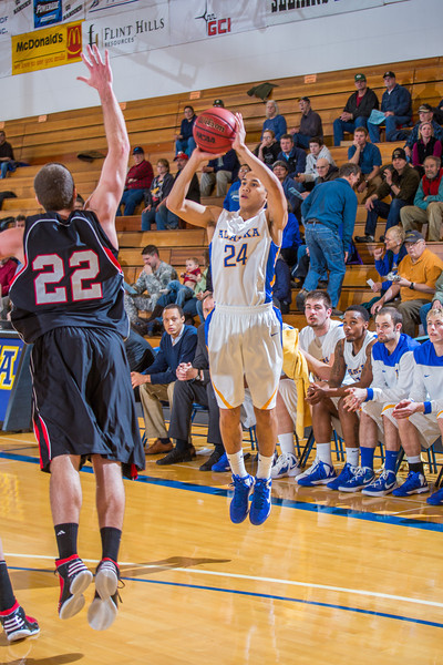 """Junior guard Pat Voeut puts up a shot from beyond the three-point line during the second half of the Nanooks' 81-58 win over Saint Martin's Jan. 10 in the Patty Center.  <div class=""""ss-paypal-button"""">Filename: ATH-13-3695-28.jpg</div><div class=""""ss-paypal-button-end"""" style=""""""""></div>"""