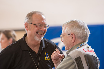 UAF Director of Athletics Gary Gray visits with photographer Paul McCarthy before a Nanooks' volleyball game in the Patty Center.  Filename: ATH-12-3638-5.jpg