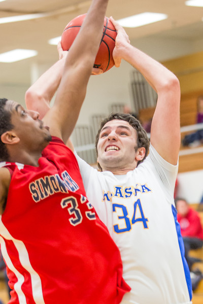 """Forward Mike Stepovich puts up a guarded jumper against Simon Fraser during another Nanook win in the Patty Gym.  <div class=""""ss-paypal-button"""">Filename: ATH-14-4029-80.jpg</div><div class=""""ss-paypal-button-end"""" style=""""""""></div>"""