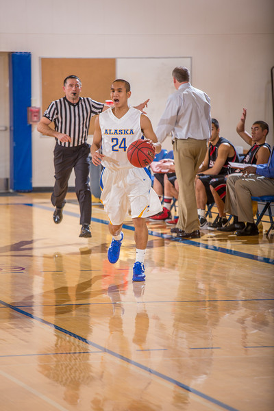 """Junior guard Pat Voeut shouts out a play while bringing the ball up the court during the second half of the Nanooks' 81-58 win over Saint Martin's Jan. 10 in the Patty Center.  <div class=""""ss-paypal-button"""">Filename: ATH-13-3695-29.jpg</div><div class=""""ss-paypal-button-end"""" style=""""""""></div>"""