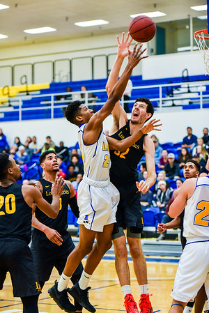 Ladonavan Wilder shoots over the outstretched hands of a player from Cal State LA during the Nanooks' game on Nov. 21 in the Patty Gym.  Filename: ATH-16-5072-36.jpg
