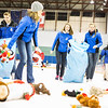 "Student athletes collect plush toys on the ice during the 3rd Annual Teddy Bear Toss at a hockey game in Carlson Center. The Student-Athlete Advisory Committee sponsored the event that collects toys for families during the holiday season.  <div class=""ss-paypal-button"">Filename: ATH-13-4011-34.jpg</div><div class=""ss-paypal-button-end"" style=""""></div>"