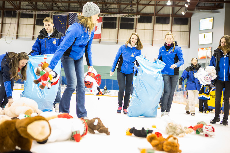 """Student athletes collect plush toys on the ice during the 3rd Annual Teddy Bear Toss at a hockey game in Carlson Center. The Student-Athlete Advisory Committee sponsored the event that collects toys for families during the holiday season.  <div class=""""ss-paypal-button"""">Filename: ATH-13-4011-34.jpg</div><div class=""""ss-paypal-button-end"""" style=""""""""></div>"""