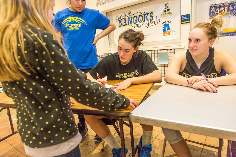 """Women's basketball players sign autographs for members of the Junior Nanooks Club between games of a Jan. 18 doubleheader in the Patty Gym.  <div class=""""ss-paypal-button"""">Filename: ATH-14-4041-97.jpg</div><div class=""""ss-paypal-button-end"""" style=""""""""></div>"""