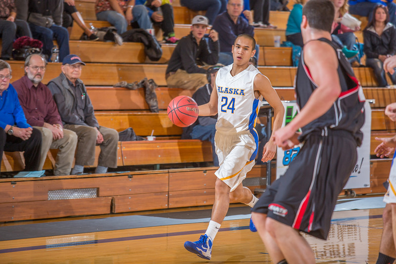 "Junior guard Pat Voeut brings the ball into the front court during the second half of the Nanooks' 81-58 win over Saint Martin's Jan. 10 in the Patty Center.  <div class=""ss-paypal-button"">Filename: ATH-13-3695-20.jpg</div><div class=""ss-paypal-button-end"" style=""""></div>"