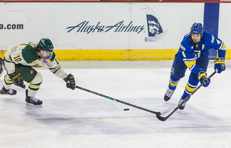 """UAF Nanook Colton Parayko takes on Brett Cameron for the puck at a match against UAA Seawolves during the first games of the Alaska Airlines Governor's Cup at the Sullivan Arena in Anchorage.  <div class=""""ss-paypal-button"""">Filename: ATH-13-4018-89.jpg</div><div class=""""ss-paypal-button-end"""" style=""""""""></div>"""