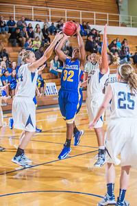 Junior April Fultz drives puts up a shot between defenders during second half action in the Nanooks' game against the Colorado School of Mines in the Patty Center.  Filename: ATH-12-3639-73.jpg