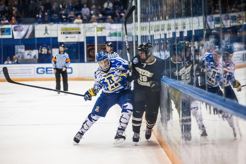 """UAF Mens Hockey Team sports on blue camouflage jerseys as part of a 10-day military appreciation event at a game against Western Michigan Nov. 16, 2012 at the Carlson Center.  <div class=""""ss-paypal-button"""">Filename: ATH-12-3656-27.jpg</div><div class=""""ss-paypal-button-end"""" style=""""""""></div>"""
