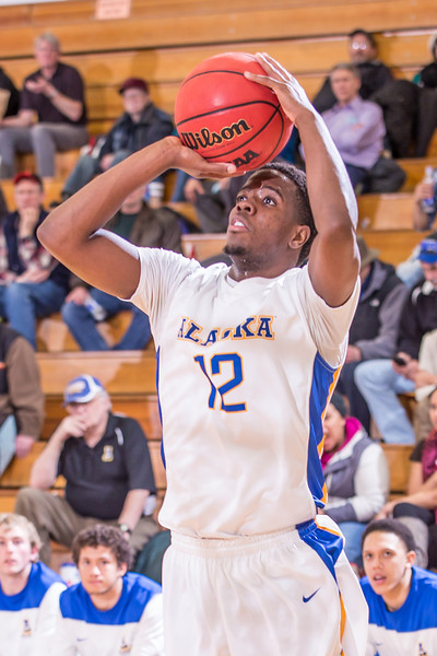 """Guard Rashaad Allen shoots an open jumper looks to score against Simon Fraser during another Nanook win in the Patty Gym.  <div class=""""ss-paypal-button"""">Filename: ATH-14-4029-113.jpg</div><div class=""""ss-paypal-button-end"""" style=""""""""></div>"""