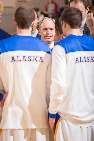 Men's basketball coach Nick Durham speaks to his team at the start of the second half of the Nanooks' 81-58 win over Saint Martin's Jan. 10 in the Patty Center. The win marked Durham's 500th game as a collegiate head coach.  Filename: ATH-13-3695-6.jpg