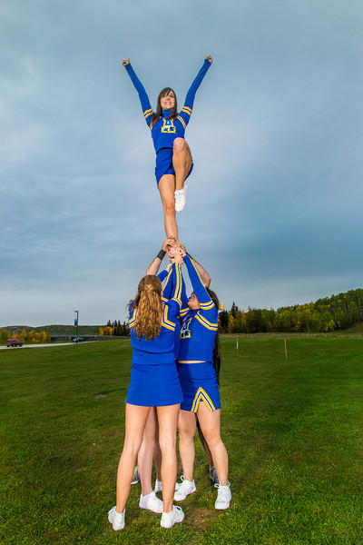 """UAF cheerleaders strike a pose in front of the SRC on the Fairbanks campus.  <div class=""""ss-paypal-button"""">Filename: ATH-13-3943-58.jpg</div><div class=""""ss-paypal-button-end"""" style=""""""""></div>"""