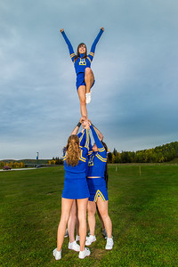 UAF cheerleaders strike a pose in front of the SRC on the Fairbanks campus.  Filename: ATH-13-3943-58.jpg