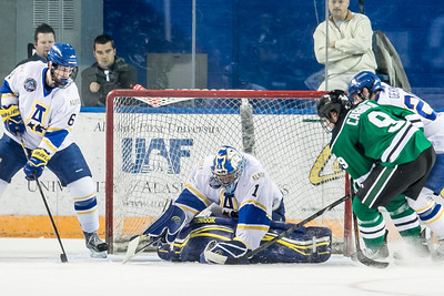 Senior goalie Steve Thompson stops another shot on goal during the Nanooks' 2-1 win over North Dakota in the Carlson Center.  Filename: ATH-12-3601-35.jpg